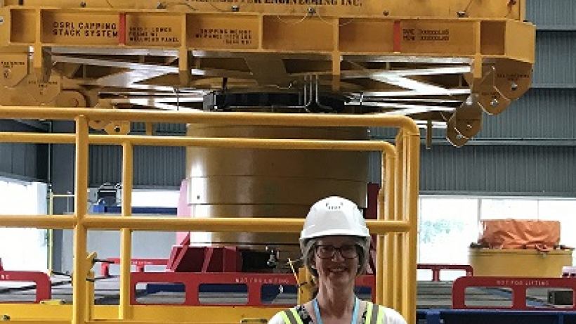 CJ standing in front of a Capping Stack for a well blowout